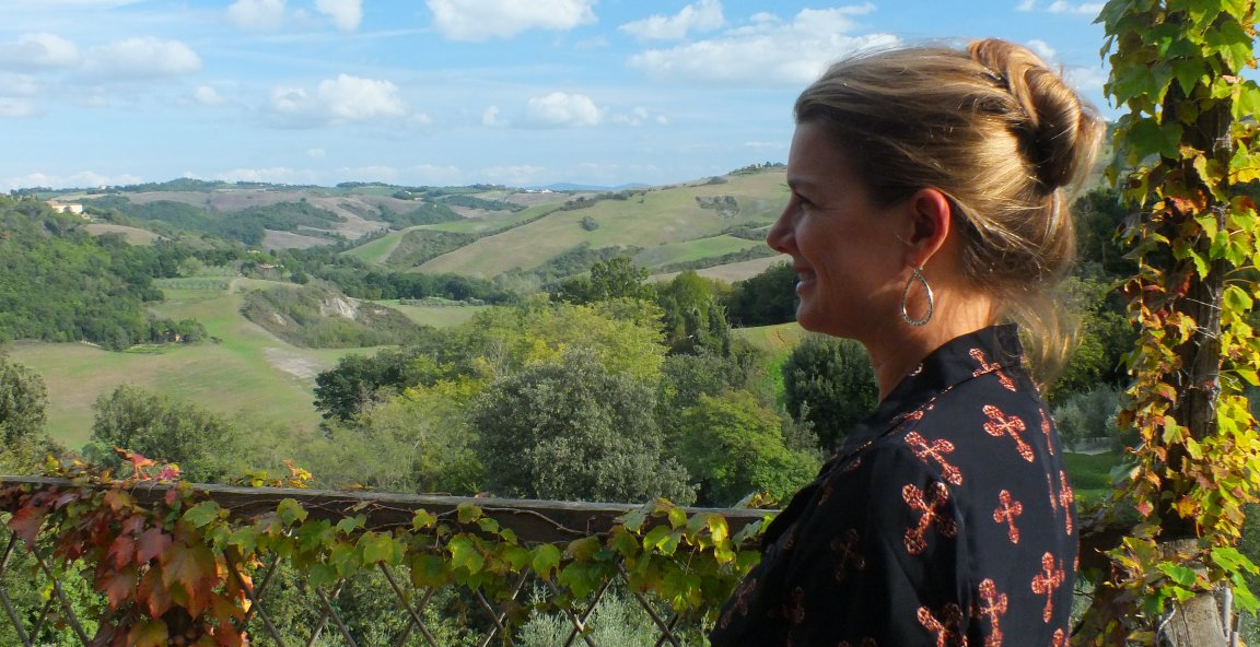 picture of Lynette, owner of Cypress tours, overlooking the Tuscan Hills near Voltera
